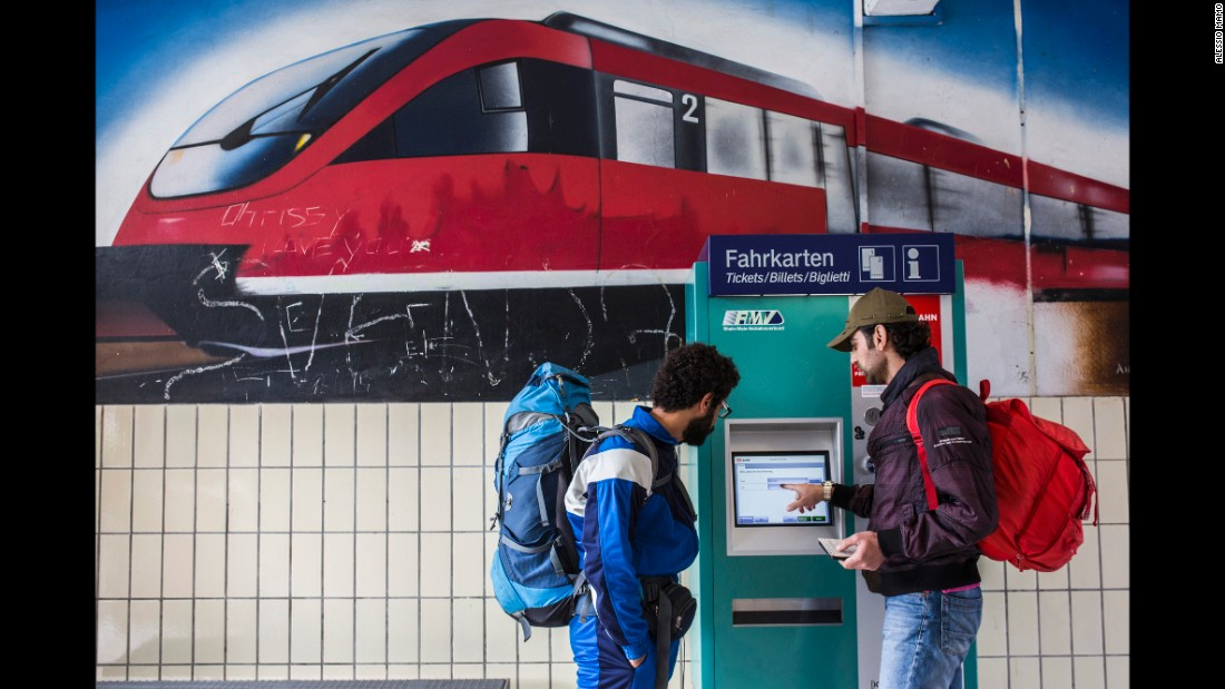 Somar buys a train ticket to Schwabisch, Germany, where his brother Mousab lives.