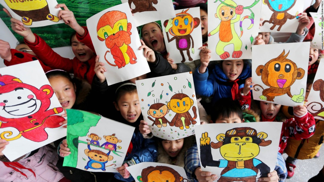 Students display their drawings at a primary school in Donghai County, China, on Thursday, January 14.