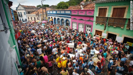 Revelers march during pre-Carnival celebrations.