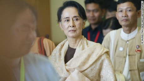 Chairperson of the National League for Democracy (NLD) Aung San Suu Kyi leaves after last day of parliament's regular session in Naypyidaw on January 29, 2016.  Myanmar's pro-democracy leader Aung San Suu Kyi applauded the military-stacked parliament on its final day in office on January 29, as one-time enemies welcomed a power transition that will loosen the army's 50-year grip on power.   AFP PHOTO / Ye Aung THU / AFP / Ye Aung Thu        (Photo credit should read YE AUNG THU/AFP/Getty Images)