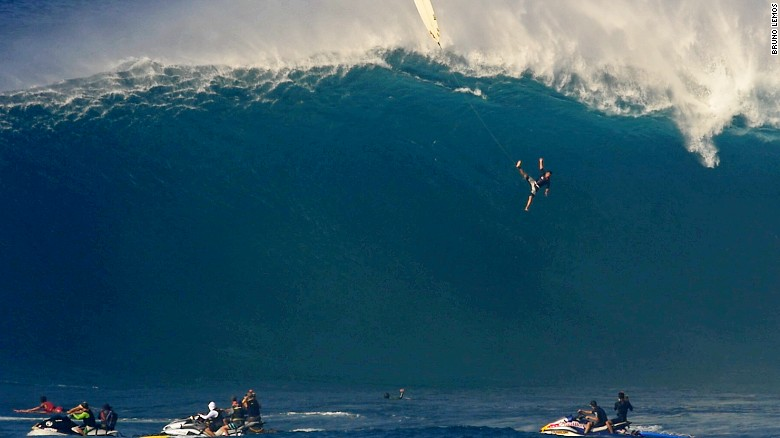 See 40-foot wave swallow surfer