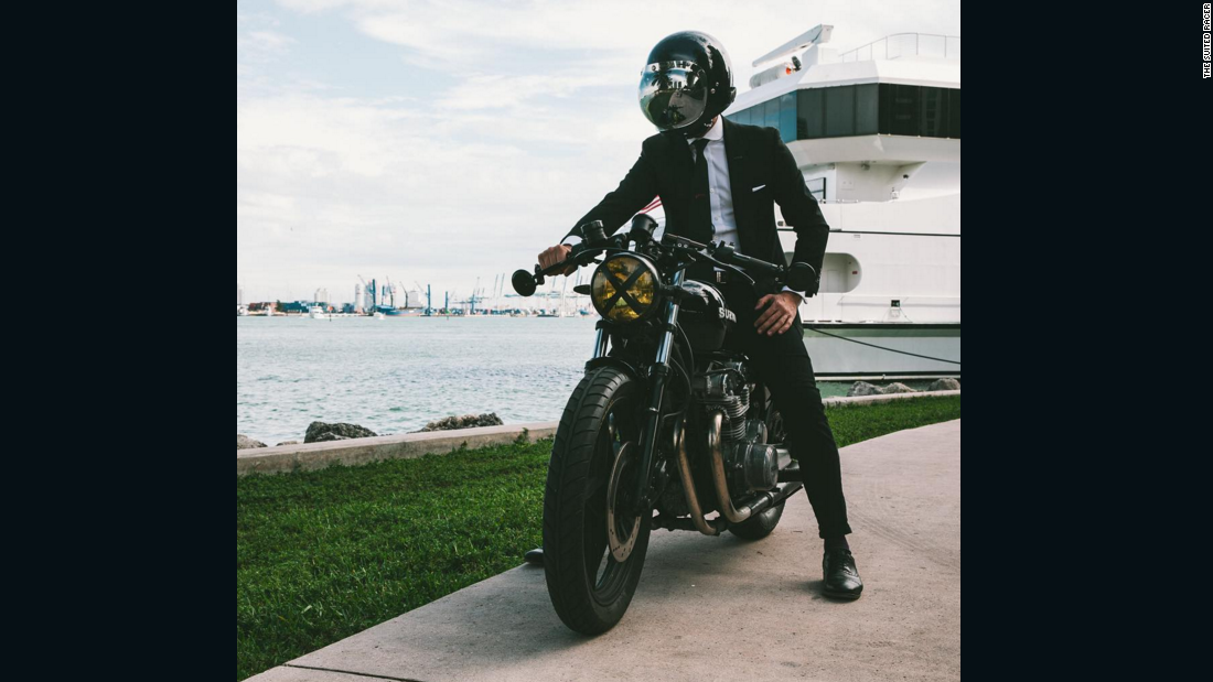 "Miami-based Instagrammer Lando Griffin, aka <a href=""https://www.instagram.com/thesuitedracer/"" target=""_blank"">The Suited Racer</a>, reviews motorcycles and suits together, providing an outlet for enthusiasts of both. His most recent ride was a classic Suzuki GS550, accompanied by a slim black Tom Ford suit and a 1971 Patek Philippe Calatrava 3445 wristwatch -- a combo straight out of a James Bond film. Dapper gents: take note."
