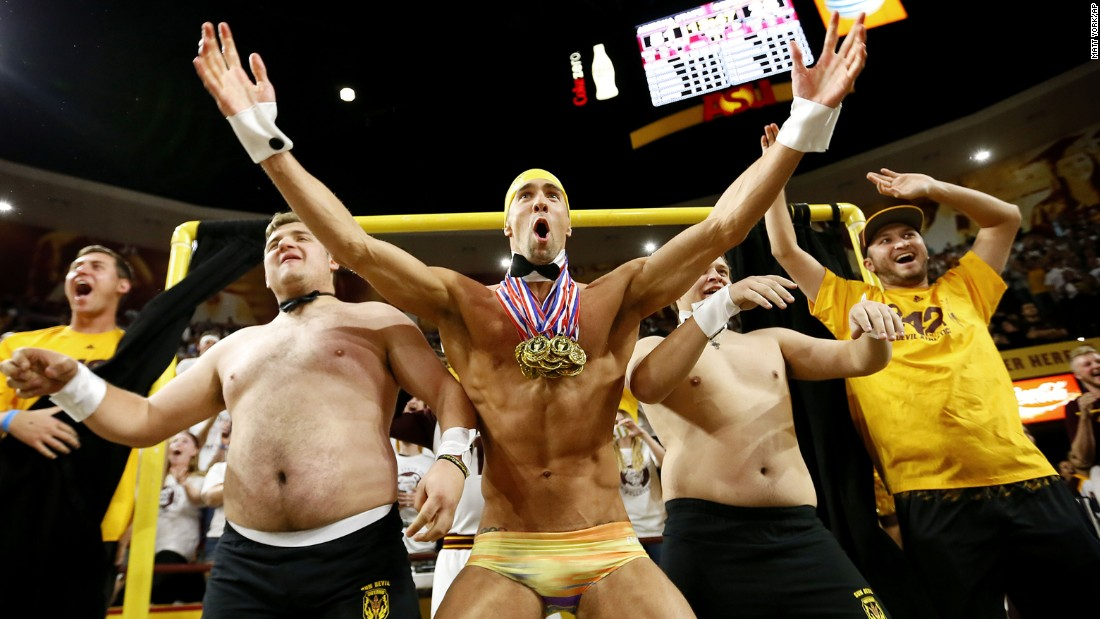"Legendary swimmer Michael Phelps helps Arizona State students try to distract a free-throw shooter during a college basketball game on Thursday, January 28. The Oregon State shooter missed both of his shots after Phelps popped out of the ""Curtain of Distraction."" <a href=""http://bleacherreport.com/articles/2612010-michael-phelps-pops-out-of-asus-curtain-of-distraction-to-distract-ft-shooter"" target=""_blank"">Watch the video</a>"