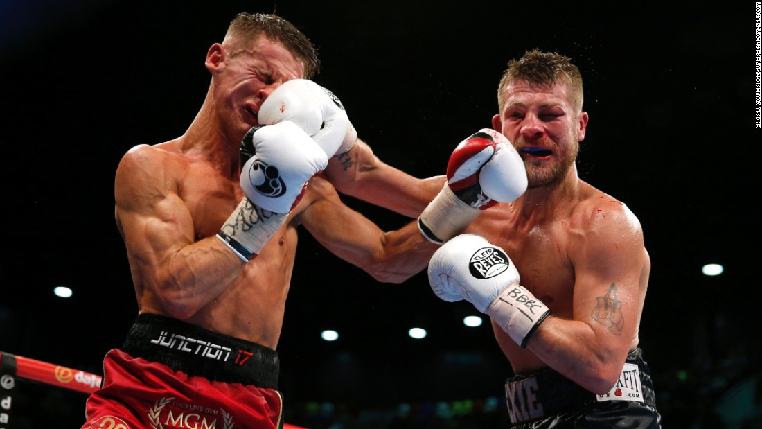 Tommy Martin, left, boxes John Wayne Hibbert during a title fight in London on Saturday, January 30. Hibbert knocked out Martin in the 12th round to retain his super-lightweight titles.