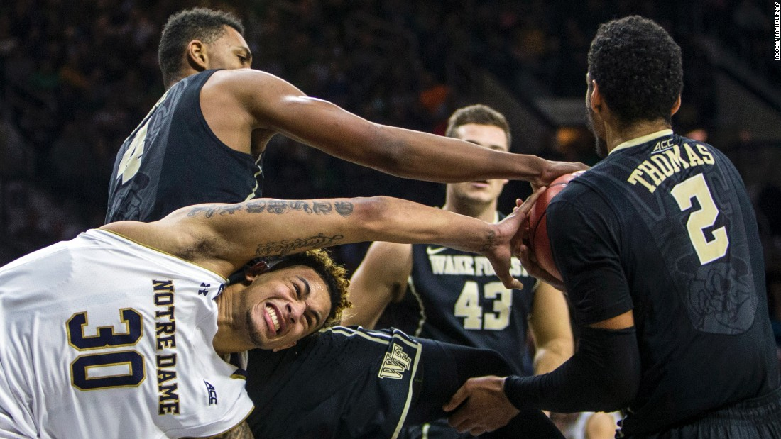 Wake Forest players steal the ball from Notre Dame's Zach Auguste during a college basketball game in South Bend, Indiana, on Sunday, January 31.
