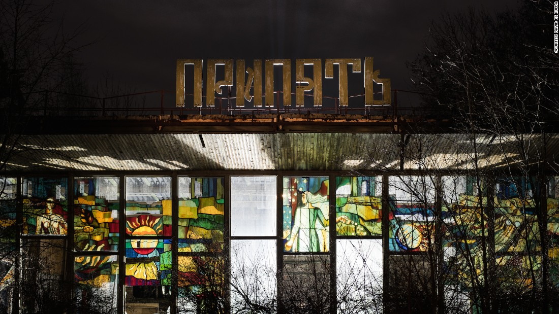 """This is a former cafe in Pripyat. I wanted to highlight the beautiful glass work and create something unique with a long exposure and light painting,"" explained De Rueda.""We constructed one main source of light inside the building, a second light behind the Pripyat sign to create a sense of depth and a third one illuminating the cafe's original sign."""