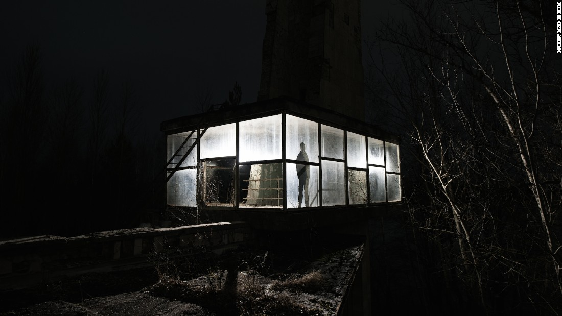 """Next to the Pripyat Cafe is the old bus station. It has this fascinating glass room built on the roof,"" added De Rueda.""I wanted to create something graphic using a long exposure and light painting. This is also a self-portrait."""