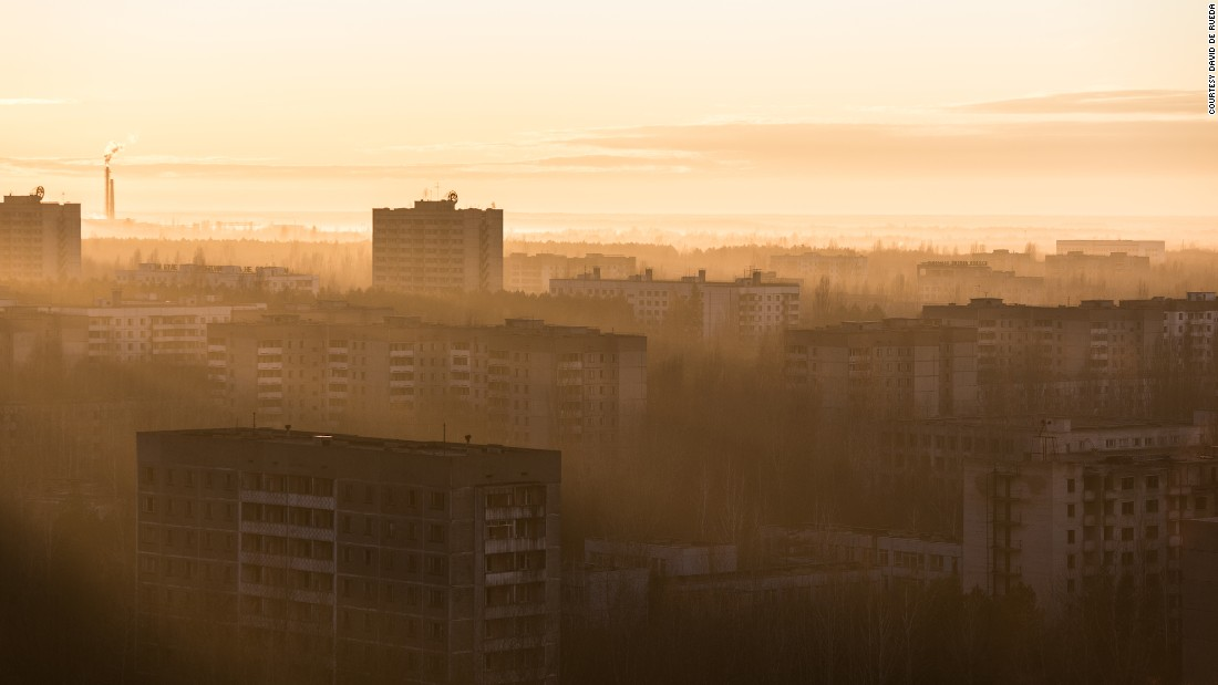 """On the second day in Pripyat, I had the chance to witness a sunrise from the top of Pripyat's highest building, the Fujiyama,"" said De Rueda.""Sun rays ran in the middle of the dead city, bringing the whole place back to life for a few short seconds."""