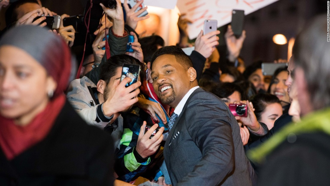 "A fan gets a selfie with actor Will Smith at the ""Concussion"" premiere in Madrid on Wednesday, January 27."