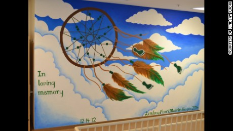 A mural painted in honor of the victims of the Sandy Hook massacre was covered over.