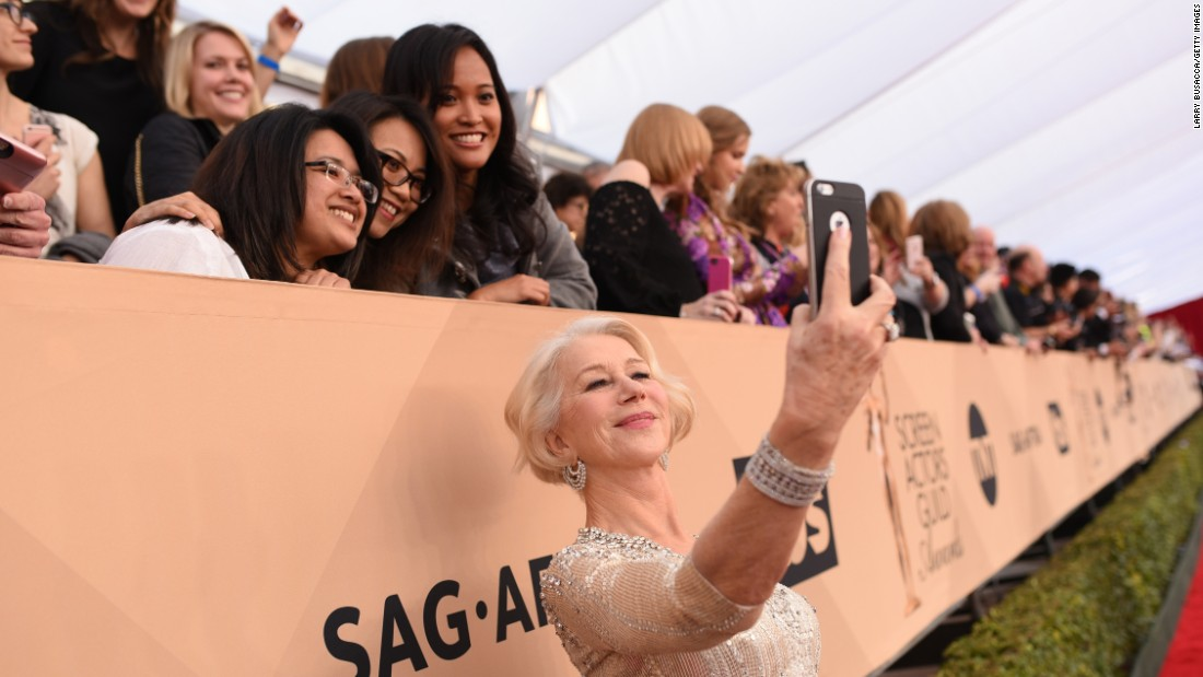 "Actress Helen Mirren takes selfies with fans Saturday, January 30, as she walks on <a href=""http://www.cnn.com/2016/01/30/entertainment/gallery/sag-red-carpet-2016/index.html"" target=""_blank"">the red carpet</a> before the Screen Actors Guild Awards."