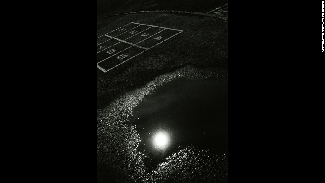This 1965 print shows a streetlight reflected in a puddle on a playground. After Draper died in 2002, his sister, Nell Draper-Winston, worked to bring attention to his life and career. The first major retrospective of his work was held in 2014.