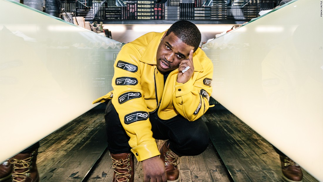 "A$AP Ferg dons his custom-made yellow leather jacket with detachable ""Ferg"" patches and lace-up Timberland Boots."