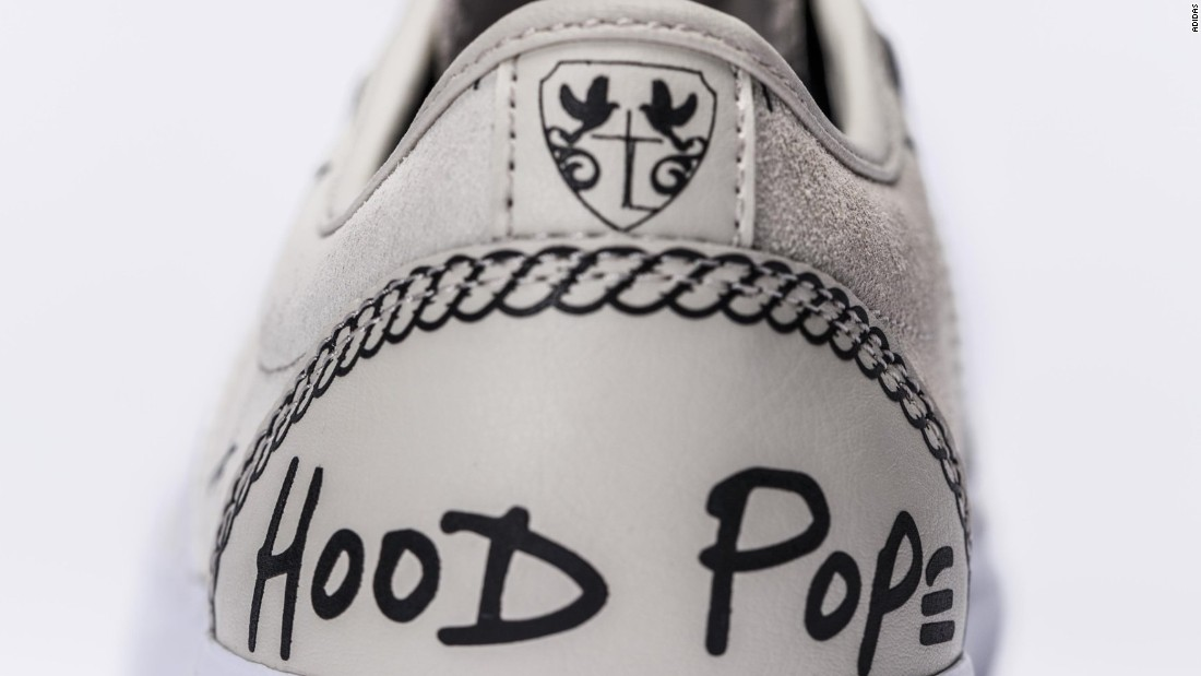 "A$AP Ferg's song logo ""Hood Pope"" is featured on the back of the Traplord Adi-Ease."