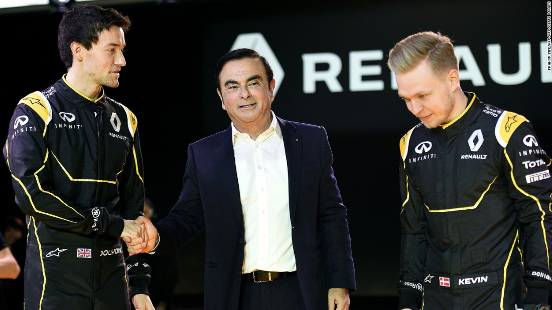 Renault President Carlos Ghosn (center) is placing the hopes of the French car manufacturer's race team in the hands of British rookie Jolyon Palmer (left) and former McLaren driver Kevin Magnussen (right).