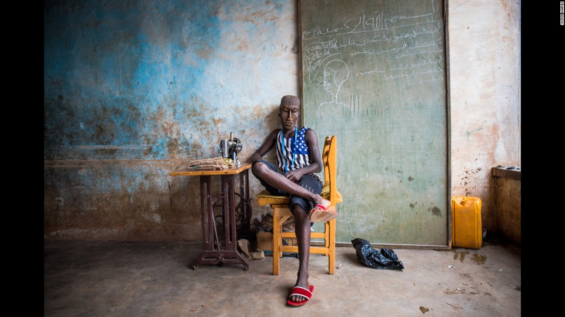"Junior, 22, wears an androgynous mask from the Fula ethnic group in this portrait taken in Ouagadougou, Burkina Faso. Photographer Selim Harbi said Junior is proudly gay and that his passion is sewing: ""He dreams to make clothes for stars and for (the poor) as well."""