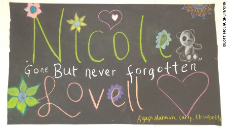 Four of Nicole Lovell's closest friends created a sign that hangs in the Blacksburg Middle School cafeteria for all the students to see.