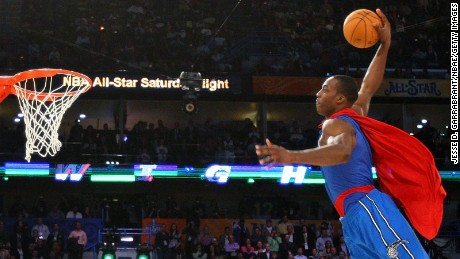 Dwight Howard #12 of the Orlando Magic completes his Superman dunk during the Sprite Slam Dunk Contest part of 2008 NBA All-Star Weekend at the New Orleans Arena on February 16, 2008 in New Orleans, Louisiana.