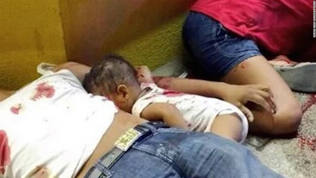 The picture of a 7-month-old baby lying dead on a sidewalk between his parents has caused fury in Mexico.