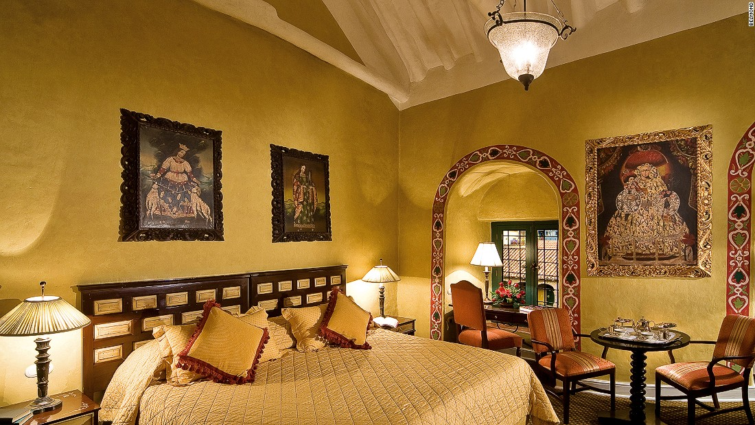 Rooms are decorated with religious art and clustered around a tranquil central courtyard.