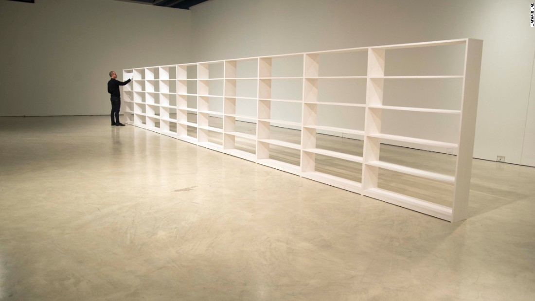 For this installation, he has created a forty foot long all white bookshelf.
