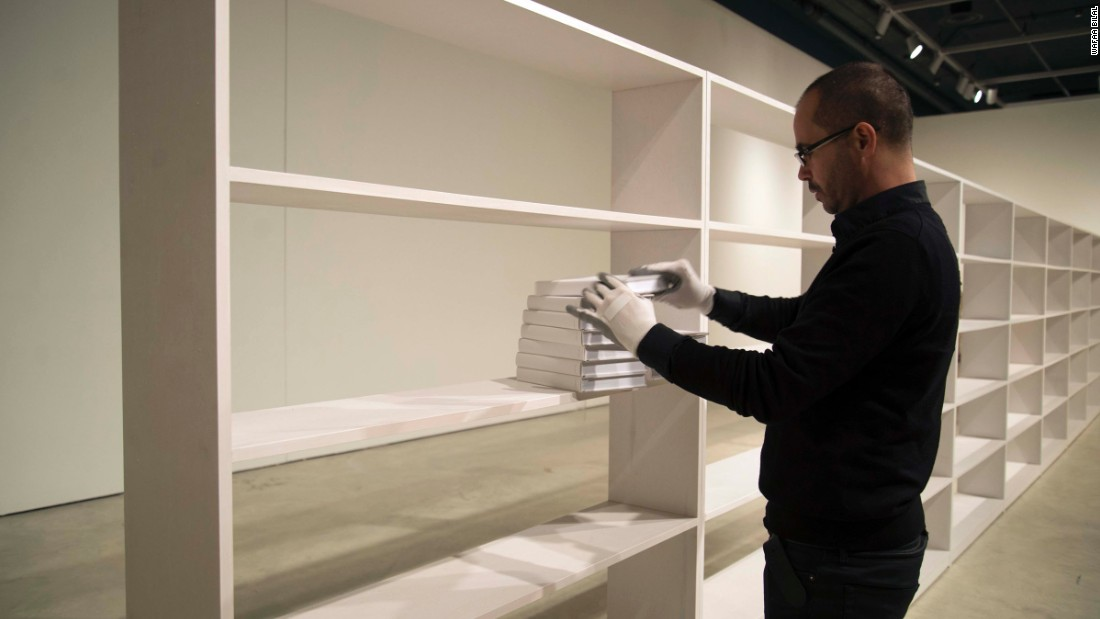 The shelf will hold 1,000 blank, white books.