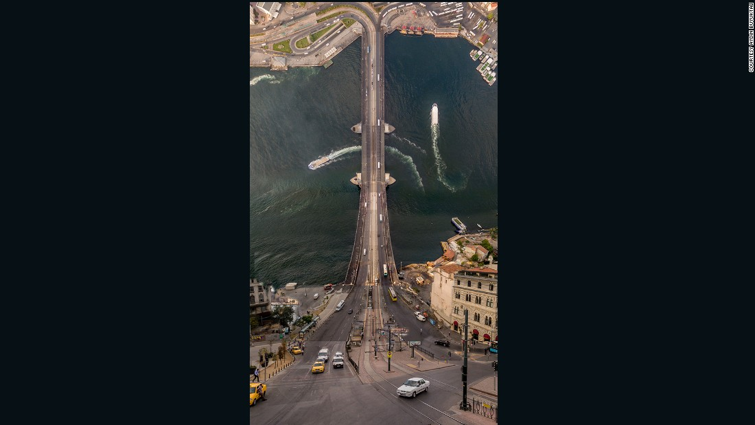 "Photographer <a href=""https://www.facebook.com/aydinbuyuktasphotography/"" target=""_blank"">Aydin Buyuktas</a> turns Istanbul's Galata Bridge into a vertigo-inducing roller coaster ride in his series ""Flatland."""