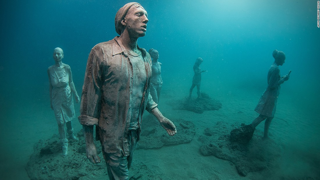 British sculptor Jason deCaires Taylor covers his exhibits in cement that attracts coral growth, then submerges them to the ocean floor, letting tropical coral overtake their surface and eventually form a new reef.