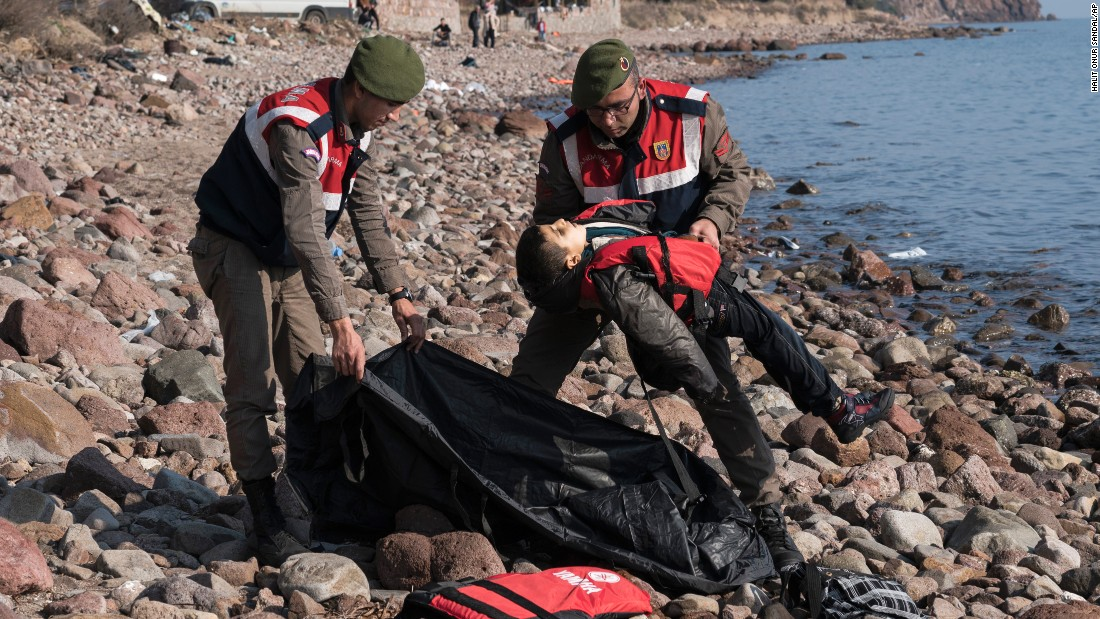 "A police officer holds the lifeless body of a boy near Ayvacik, Turkey, on Saturday, January 30. At least 33 people, including five children, were reportedly killed when a boat carrying migrants to Greece <a href=""http://www.cnn.com/2016/01/30/world/europe-migrant-deaths/"" target=""_blank"">capsized off the Turkish coast.</a> Greece is a major destination for those trying to escape war and poverty and get into Europe."