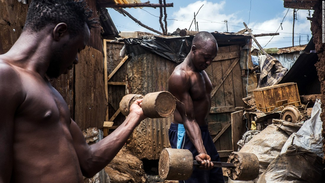 Men lift homemade weights at a slum in Nairobi, Kenya, on Tuesday, February 2.