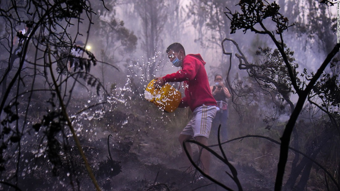 People try to put out a forest fire in Bogota, Colombia, on Tuesday, February 2.
