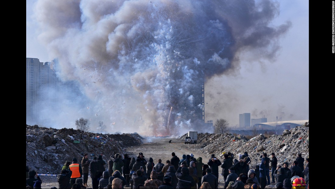People watch police destroy confiscated firecrackers in Shenyang, China, on Friday, January 29.