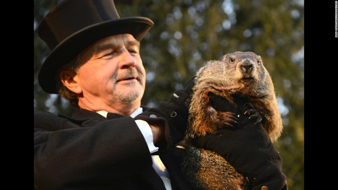 "John Griffiths holds up Punxsutawney Phil after the famous Pennsylvania groundhog <a href=""http://www.cnn.com/2016/02/02/living/groundhog-day-punxsutawney-phil/"" target=""_blank"">made his annual weather prediction</a> on Tuesday, February 2. Phil didn't see his shadow, and according to legend, that means an early spring."