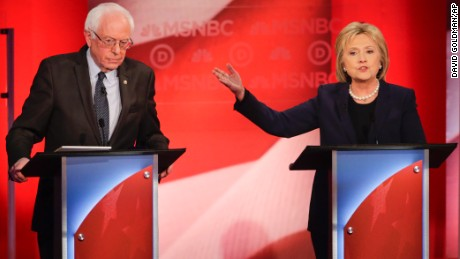 Democratic presidential candidate, Sen. Bernie Sanders, I-Vt,  listens as Democratic presidential candidate, Hillary Clinton  answers a question during a Democratic presidential primary debate hosted by MSNBC at the University of New Hampshire Thursday, Feb. 4, 2016, in Durham, N.H. (AP Photo/David Goldman)