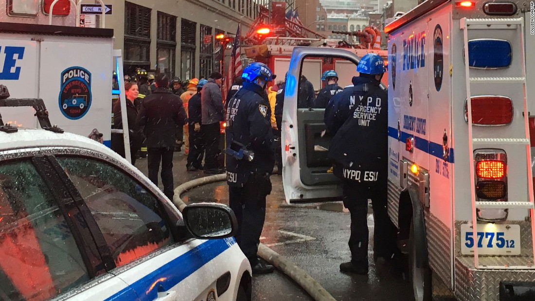 Emergency workers gather at the scene of the collapse.