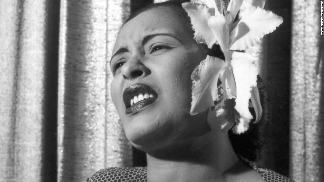 "Despite little formal training, jazz singer <strong>Billie Holiday</strong> (1915-1959) thrilled audiences in the '40s and '50s with her vulnerable voice and inimitable stylings. Her take on Gershwin's ""The Man I Love"" is a classic. Here she's seen singing with an orchid in her hair in the early 1950s."