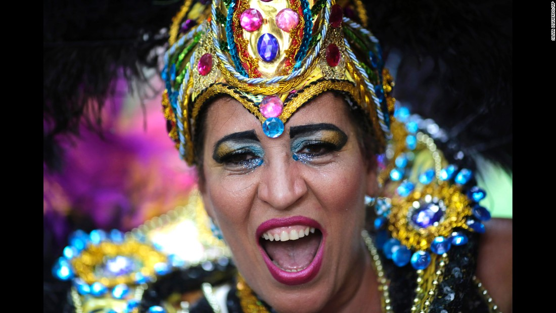 A reveler dances in costume during a parade in Rio de Janeiro on February 4.