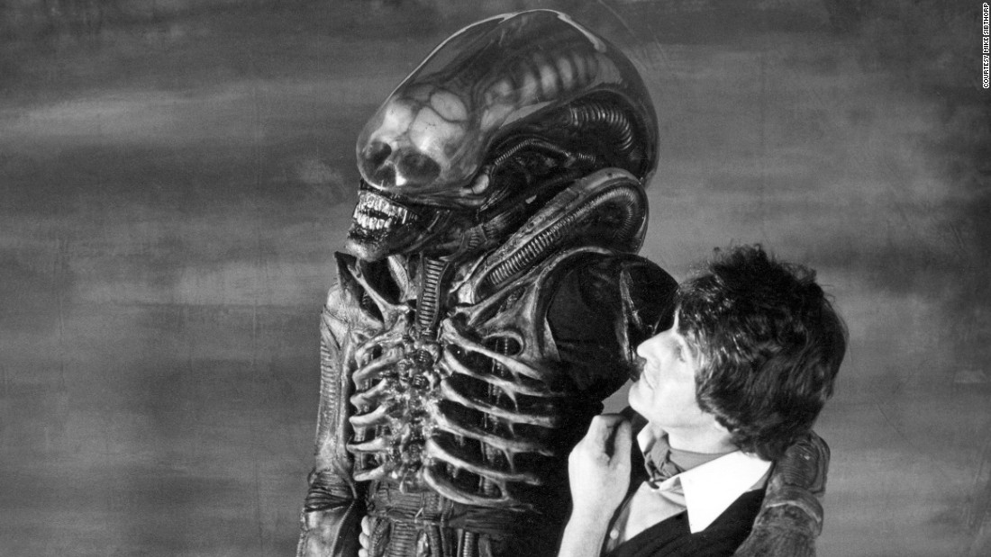 Badejo, seen here with dresser John Birkinshaw inside Bray Studios. The design for the alien's costume was the brainchild of H.R. Giger, who created concepts for many of the sets. Made from latex, the fitting process was long and arduous, not to mention uncomfortable for Badejo.