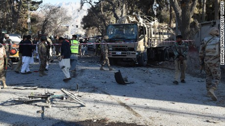 Soldiers examine a bomb explosion site in Quetta, Pakistan.