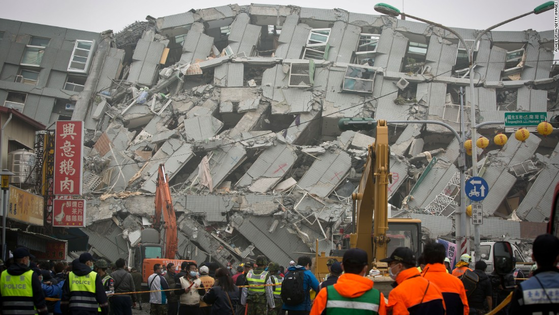 Rescue personnel search for survivors at the site of a collapsed building, the Weiguan Jinlong residential complex, in Tainan on February 6.
