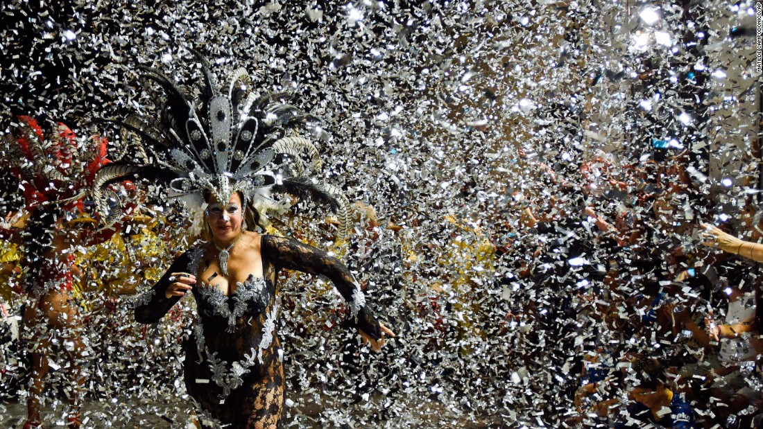 Confetti surrounds a dancer of during a Carnival parade in Montevideo, Uruguay, on Friday, February 5.