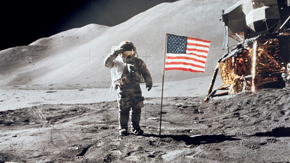 Scott salutes the U.S. flag during an Apollo 15 moonwalk.