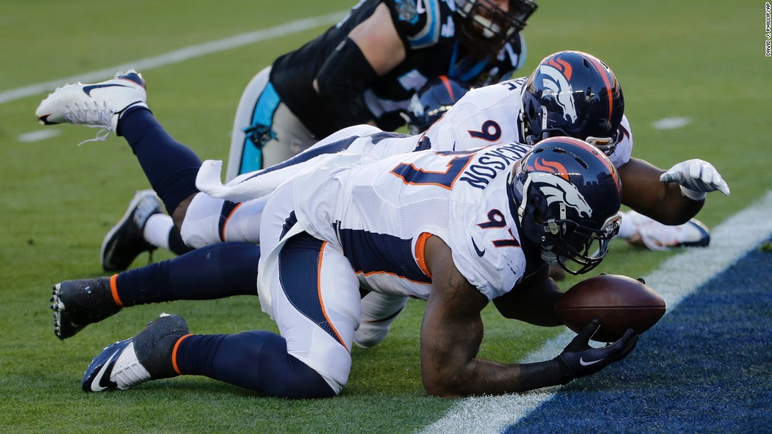 Denver's Malik Jackson recovers a Newton fumble in the end zone, scoring a touchdown that helped give the Broncos a 10-0 lead in the first quarter.