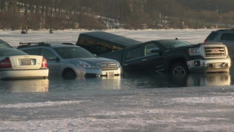 cars fall through icy lake pkg_00005304