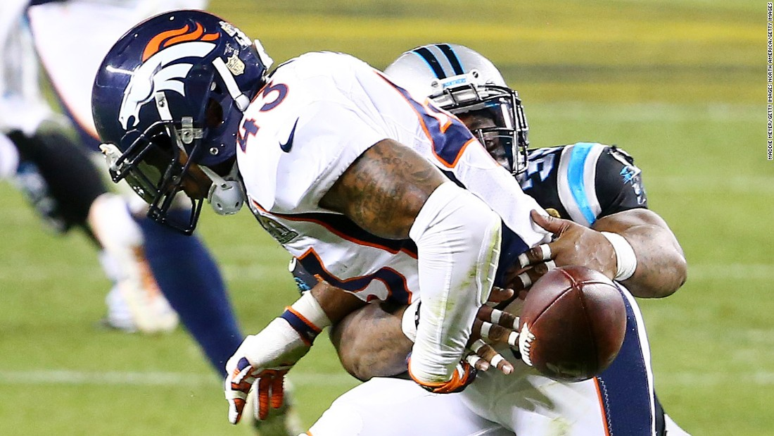 Carolina fullback Mike Tolbert strips the ball from Ward after Ward intercepted a pass in the third quarter. Denver recovered the ball.