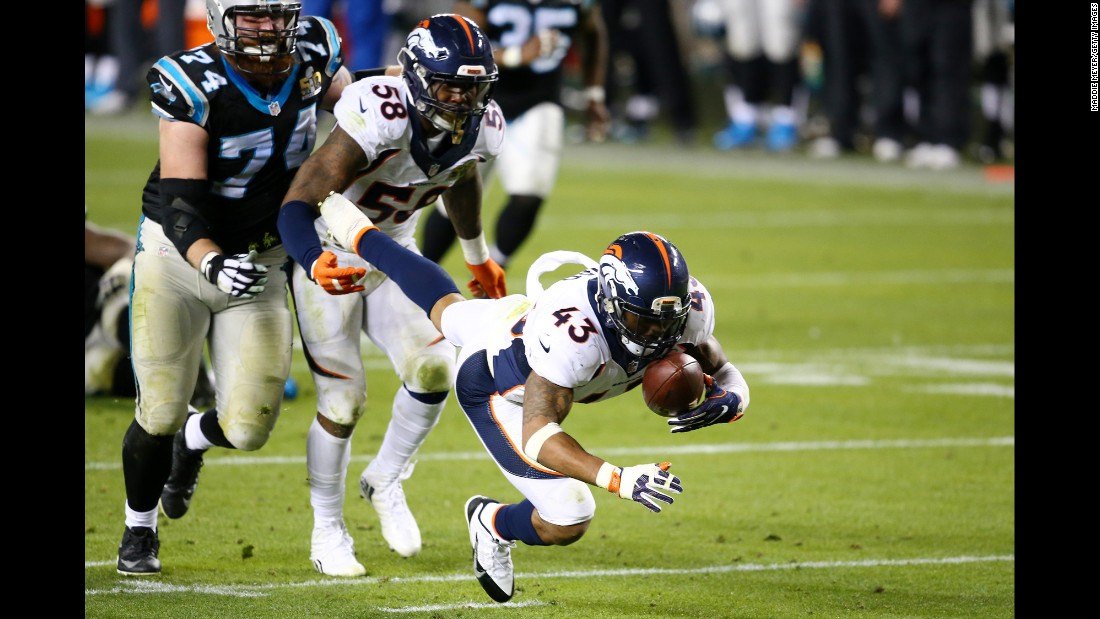 Denver safety T.J. Ward recovers a fumble deep in Carolina territory after teammate Von Miller hit Newton in the fourth quarter. It was one of two fumbles forced by Miller in the game.