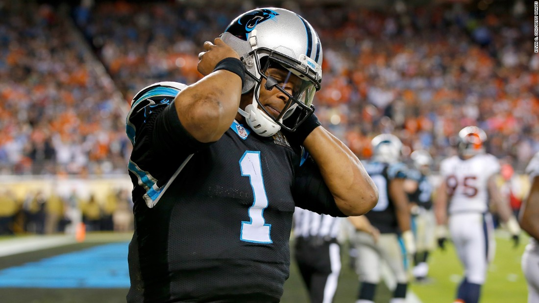 Panthers quarterback Cam Newton -- the league's Most Valuable Player this season -- reacts after a play in the fourth quarter. He was sacked six times by the dominant Denver defense, which was also credited with a sack on Ted Ginn Jr.