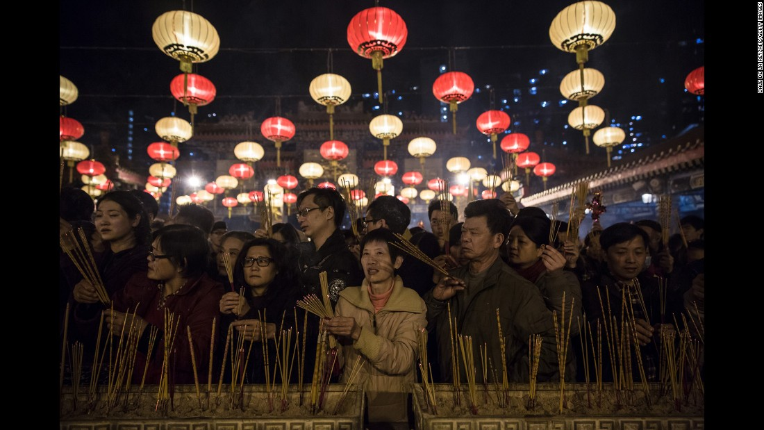 People pray and burn joss sticks at the Wong Tai Sin Temple in Hong Kong on February 8.