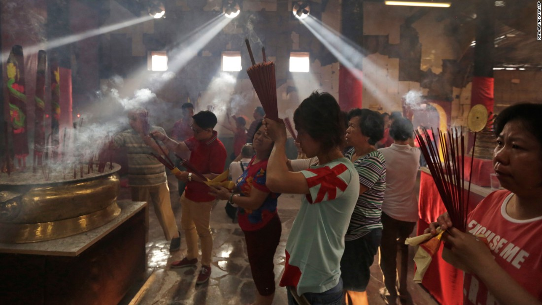 People pray at the Dharma Bhakti Temple in Jakarta, Indonesia, on February 8.