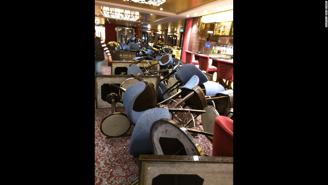 The storm flipped over chairs and tables aboard the Anthem of the Seas. Four people were injured, the cruise line said, but none seriously.